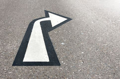White arrow on asphalt Stock Photos