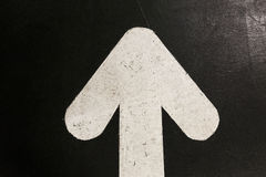 White arrow on black background Stock Photos