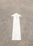 White arrow mark on the road. Stock Photo