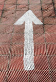 White arrow painted on a parking floor Royalty Free Stock Photography