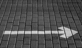White arrow with right direction on the pavement. Signs and symbols stock images