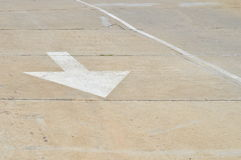 White arrow on the road. Stock Image