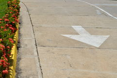 White arrow on the road. Stock Images