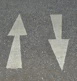 White arrow sign on asphalt road Stock Photo
