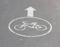 White arrow and sign a bicycle. Stock Photography