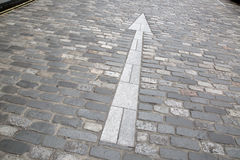 White Arrow Sign, Cobbled Stone Street, St Andrews, Fife, Scotla Stock Photo