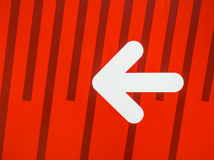 White arrow sign on red background Royalty Free Stock Images