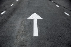 White Arrow Straight Ahead Traffic Signs perspective on the road royalty free stock photography