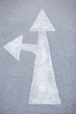 White arrow two head. White arrow two way on the road. arrow turn and go to the way on the road Royalty Free Stock Photo
