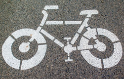 White arrows and bicycle sign path Stock Photography