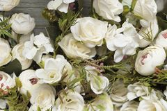 White Artificial flowers of different types and colors royalty free stock images