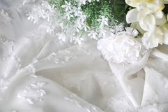 White Artificial Flowers on Fabric Stock Images