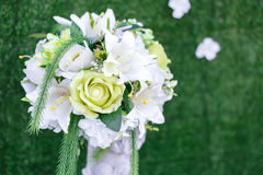 White artificial rose. White and green artificial rose bouquet for wedding party decotation Stock Photo