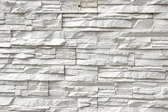 White Artificial Stone Wall. Background and Texture for text or image Royalty Free Stock Photography