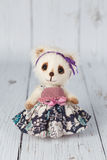 White artist teddy bear in pink dress one of kind Royalty Free Stock Photo