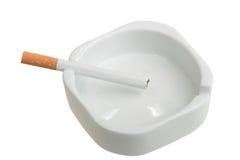 White ashtray with cigarette Royalty Free Stock Photos