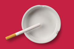 White ashtray and cigarette Royalty Free Stock Image