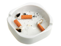 White ashtray with group a smoking butts. Royalty Free Stock Photography