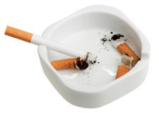 White ashtray with a smoking butts and cigarette. Stock Image