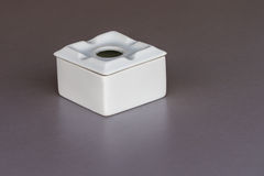 White ashtray on a table close-up. Image of white ashtray on a table close-up Stock Images