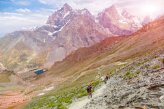 White Asian mountain footpath and group of hikers Royalty Free Stock Image