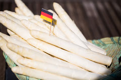 White asparagus in the basket, green background. German asparagus Royalty Free Stock Images