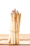 White asparagus bundle on wooden surface Stock Photos