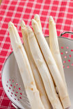 White asparagus in colander Stock Photos