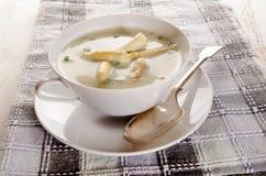 White asparagus cream soup in a bowl Stock Photo