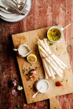 White Asparagus on Cutting Board with Herbs Stock Image