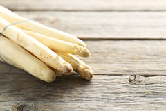 White asparagus. Fresh white asparagus on a grey wooden table royalty free stock photo