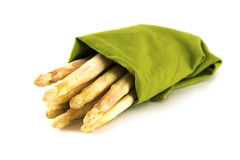 White asparagus, fresh from the market in a green towel isolated Stock Image