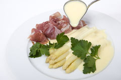 White asparagus with ham and hollandaise sauce Royalty Free Stock Photo