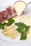 White asparagus with ham and hollandaise sauce Stock Photo