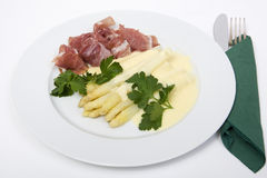 White asparagus with ham and hollandaise sauce Royalty Free Stock Images