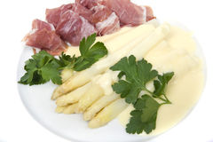 White asparagus with ham and hollandaise sauce Royalty Free Stock Photos