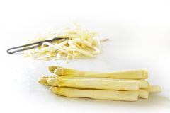 White asparagus and peel in the bright background, copy space Stock Photos