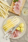 White asparagus with potatoes and boiled ham Stock Photo