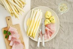 White asparagus with potatoes and boiled ham Royalty Free Stock Image