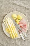 White asparagus with potatoes and boiled ham Stock Photography