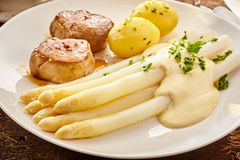 White asparagus, with potatoes and meat Stock Images