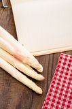 White asparagus with red checkered cloth. And rustic paper Royalty Free Stock Photography