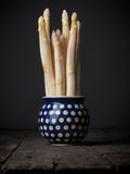 White asparagus in a rustic bowl Stock Images