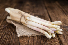 White Asparagus (selective focus) on wooden background Royalty Free Stock Images