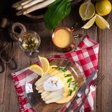 White asparagus served with a fine hollandaise sauce and Poache Royalty Free Stock Photography