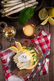 White asparagus served with a fine hollandaise sauce and Poache Royalty Free Stock Photo