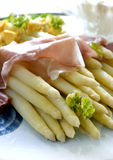 White asparagus served with ham and sliced boiled Stock Photos