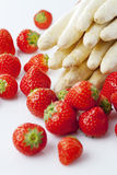White asparagus and strawberries Royalty Free Stock Photos