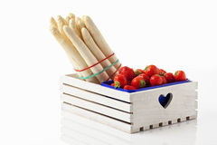 White asparagus and strawberries in wooden box Royalty Free Stock Photo