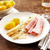 White asparagus tips with gammon Stock Photography